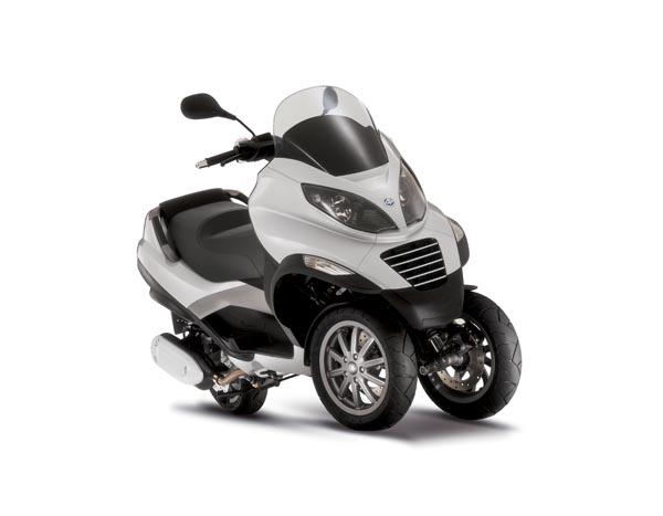 Honda Motorcycles Calgary >> Calgary Herald, Scooters Rule by Greg Williams – Greg Williams